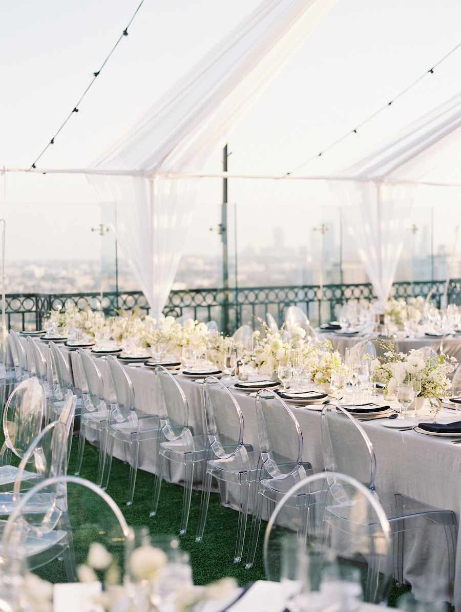guest seating on rooftop with string lighting