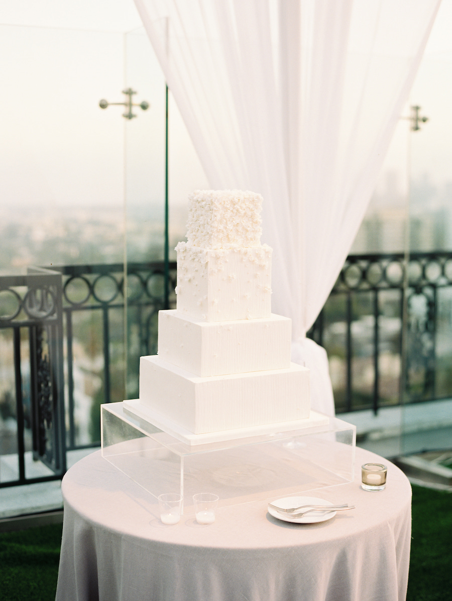 all white wedding cake with white floral design in los angeles