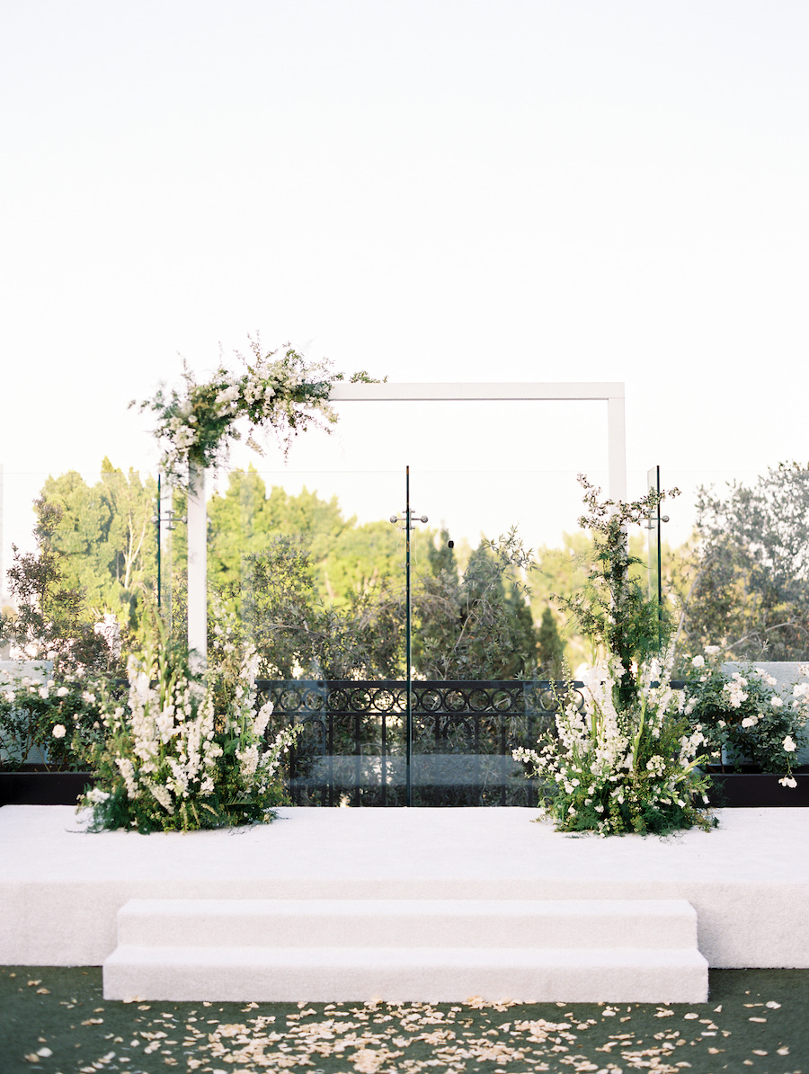 white floral arch on rooftop in los angeles