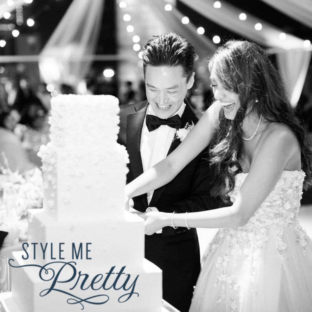 newlywed couple cutting wedding cake featured on style me pretty