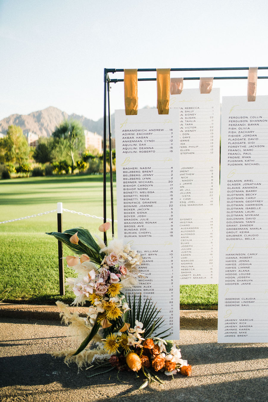 unique table seating chart at outdoor wedding