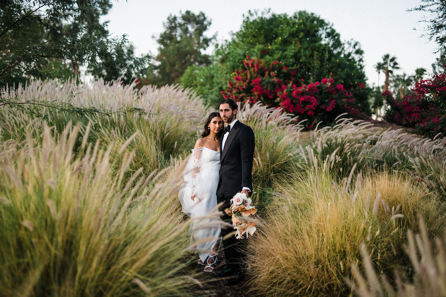bride and groom boho photo with pompas grass