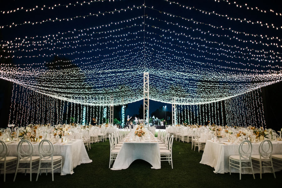 string lighting canopy on golf resort outdoor wedding