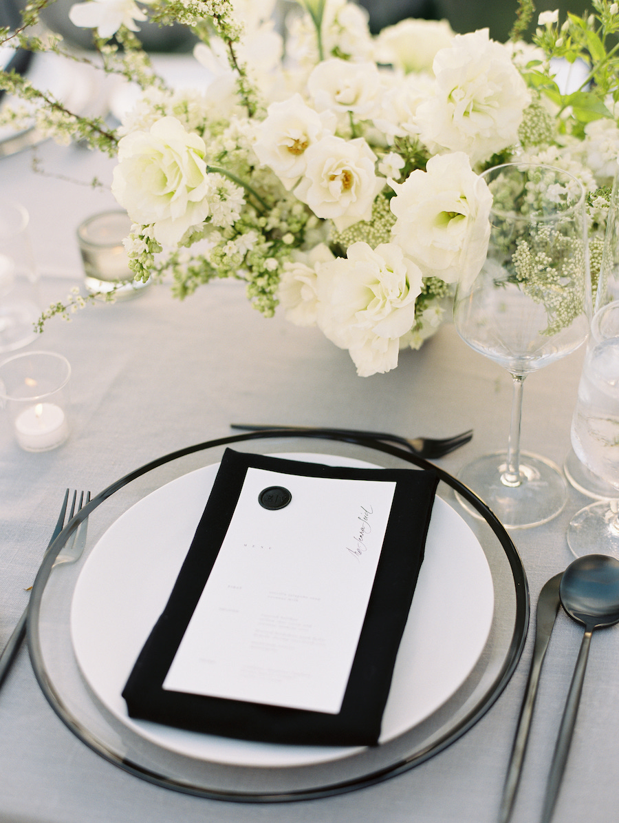 wedding dinner menu and floral centerpiece