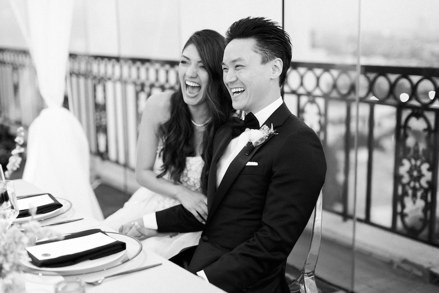 bride and groom laughing at romantic wedding
