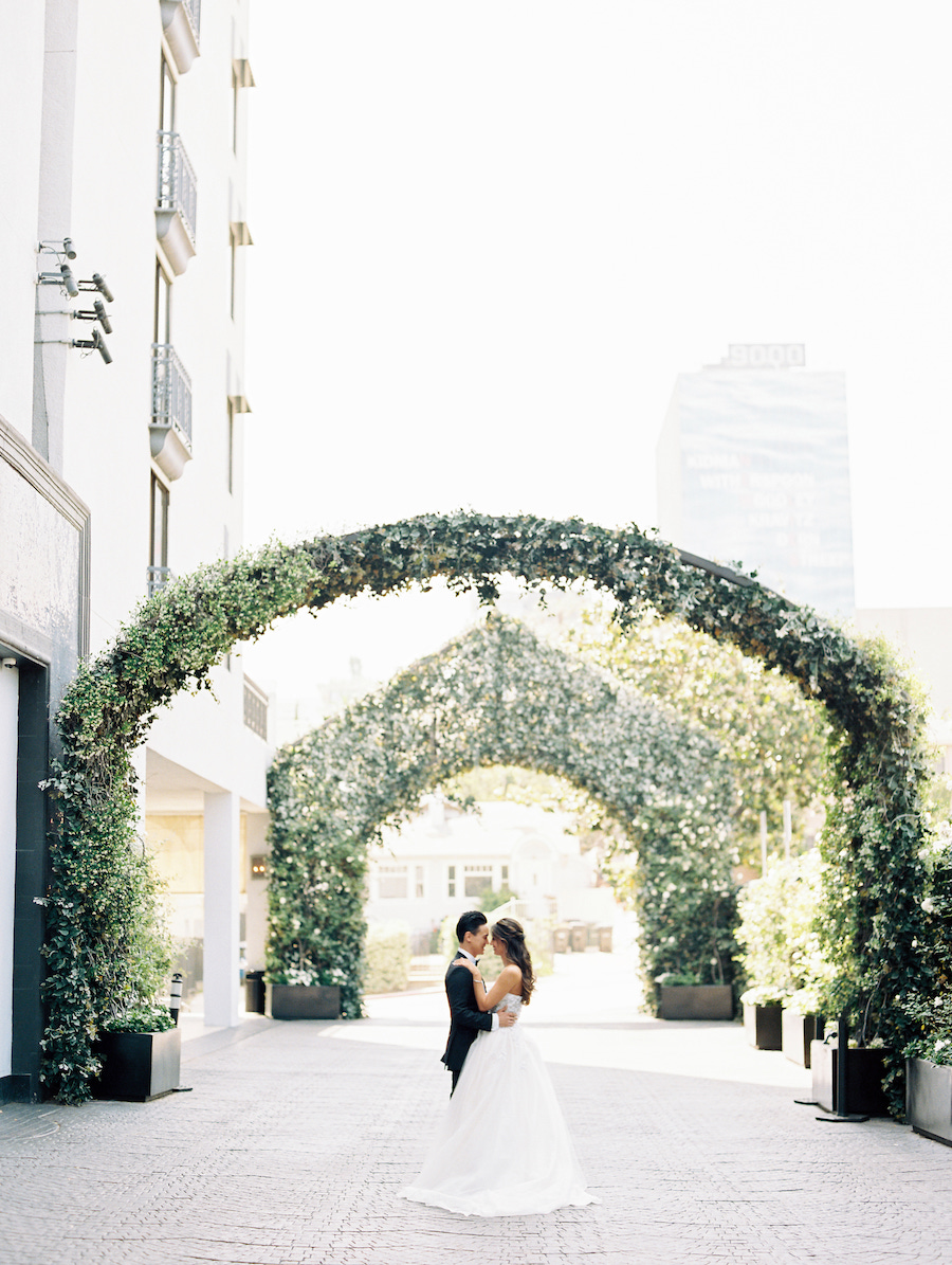 bride and room under vine arches