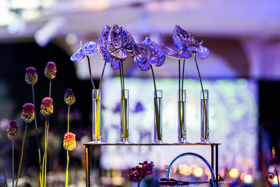 purple flowers in beakers at chemistry themed bar mitzvah in beverly hills hotel