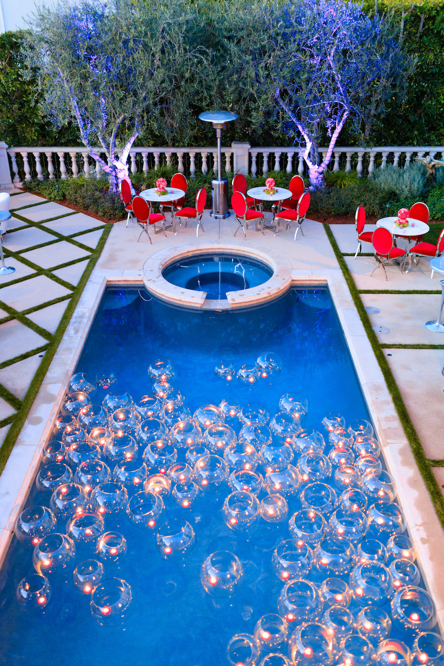 view of pool with tea candles and lounge area