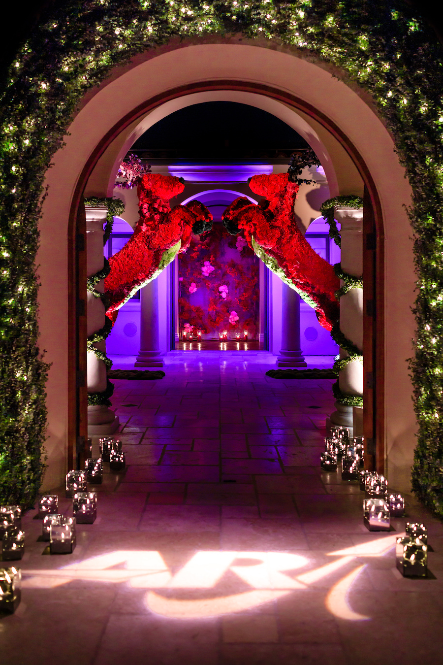 entryway with two large reindeers at holiday event