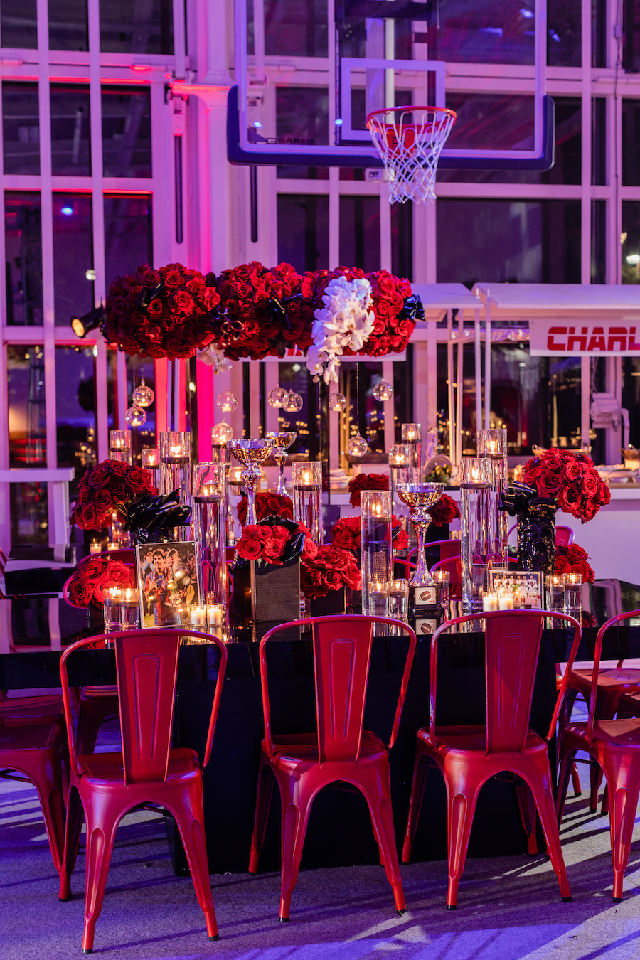 table decor with red chairs and red roses at bar mitzvah