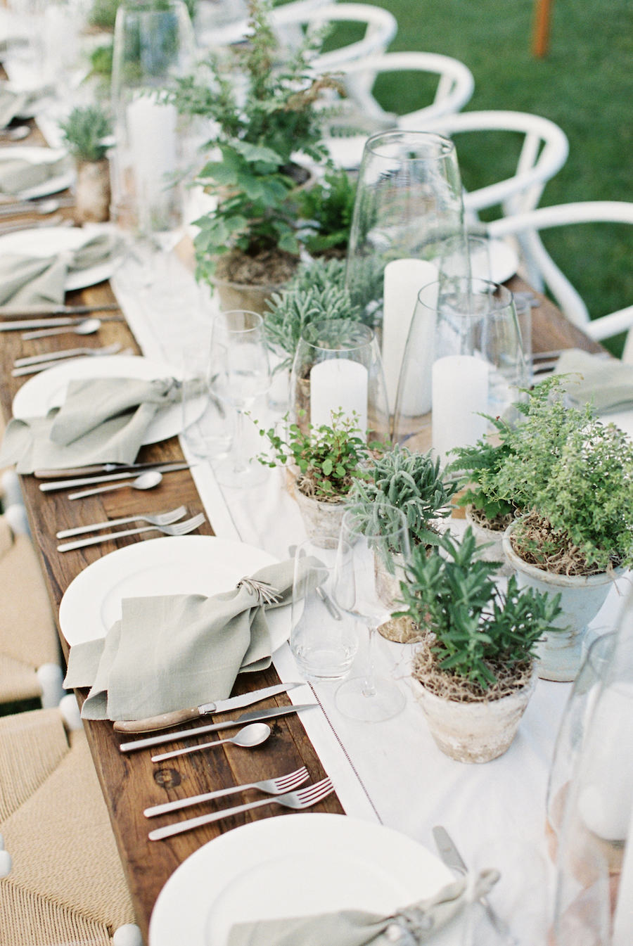 tabletop decor with green plants at wedding