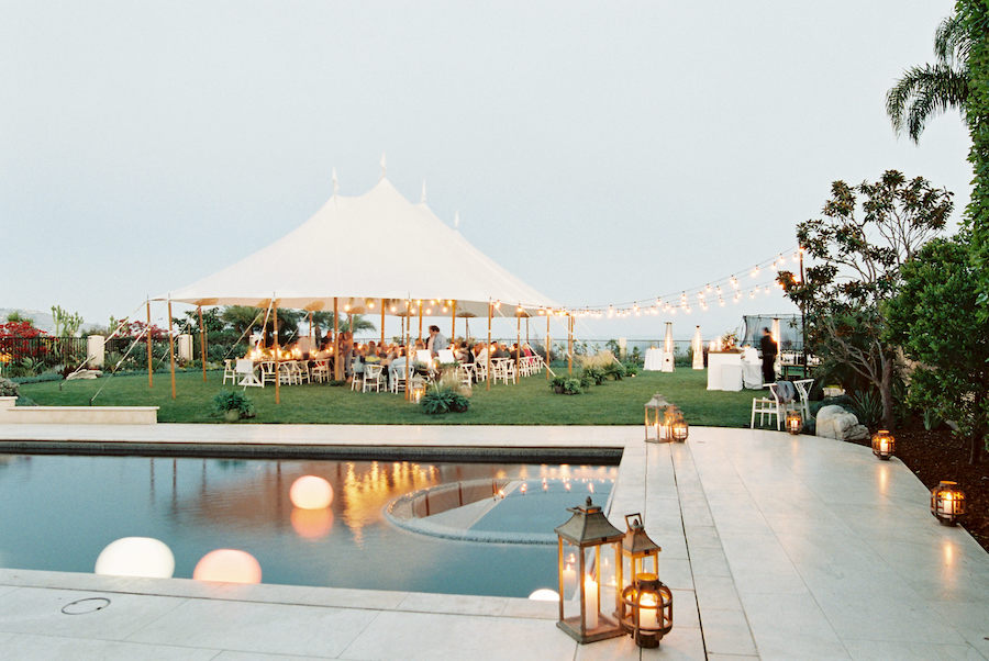 outdoor wedding by poolside during sunset