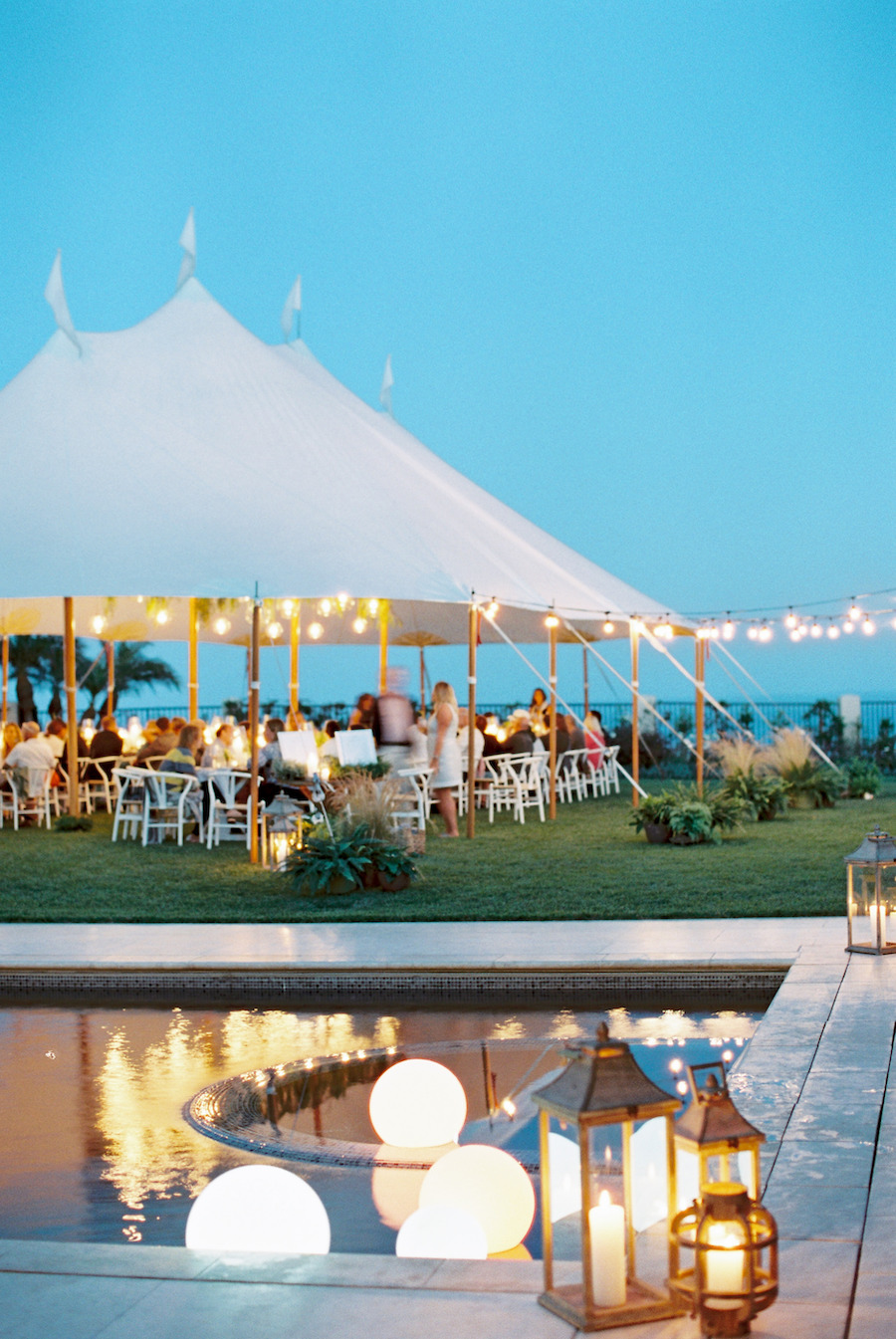 coastal wedding reception in california with string lighting