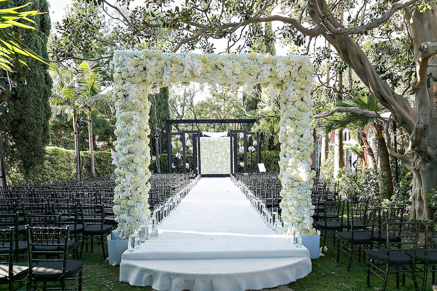 wedding ceremony details with floral arch