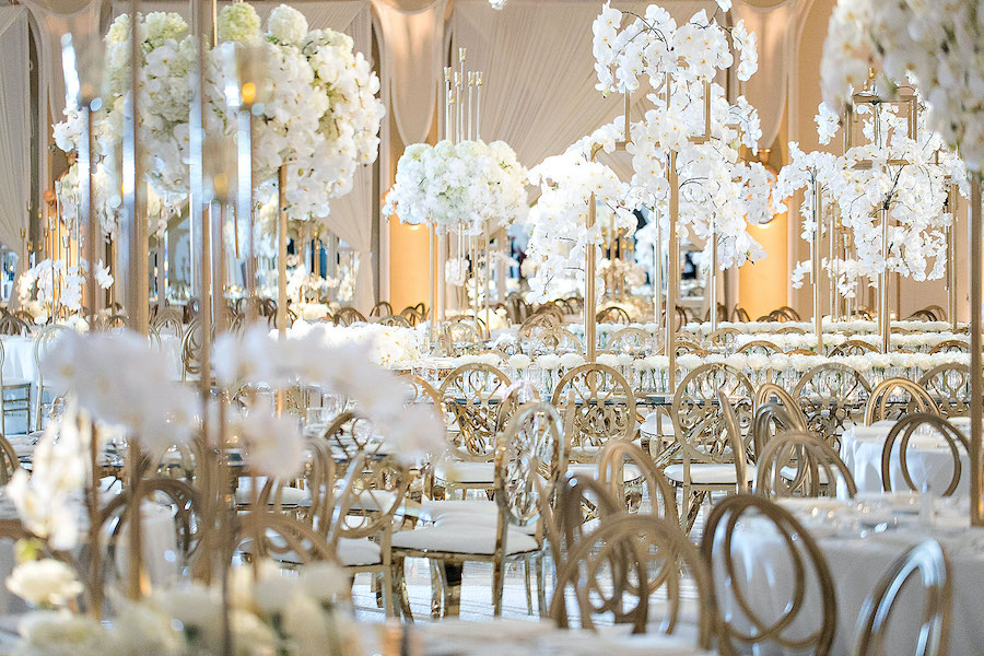 gold and white tabletop decor at wedding